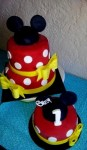 Mickey Mouse Cake and smash cake, both featuring fondant bows and Mickey ears. Feeds 25-30. MRSP $130