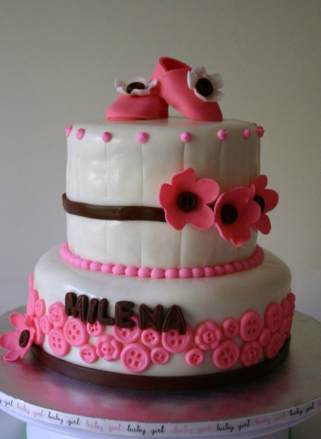 Pink and brown baby shower cake with gumpaste booties