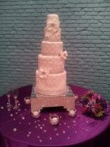 """Athena"" 5 tiers of quilted pattern and diamonds. Also sporting fondant bows with diamond jewels."