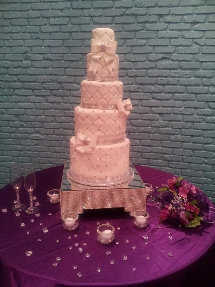 """""""Athena"""" 5 tiers of quilted pattern and diamonds. Also sporting fondant bows with diamond jewels."""