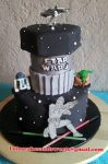 Star Wars birthday cake featuring Yoda, R2D2, a Storm Trooper and light sabers. Cake topper was a metal replica of ship, provided by consumer. Feeds 25-30. MSRP $150