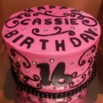 Sweet 16 cake in pink vanilla buttercream with black scrolls and diamond jewels. Feeds 20-25. MSRP $125