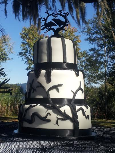 """""""Raven"""" Edgar Allen Poe inspired wedding cake with creepy trees, black blood and a raven topper. Inside cake, appropriately themed, was red velvet and pumpkin spice."""