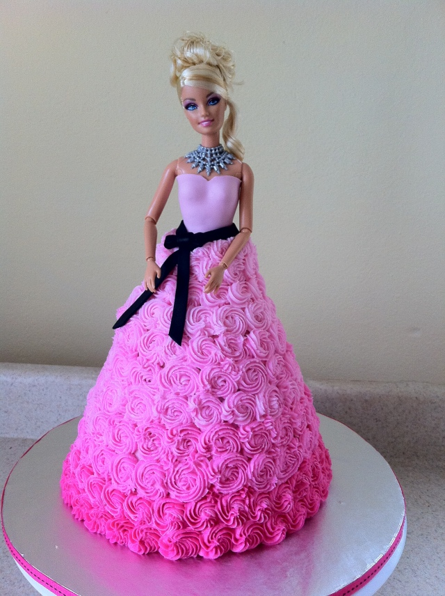 Pink swirl Barbie birthday cake