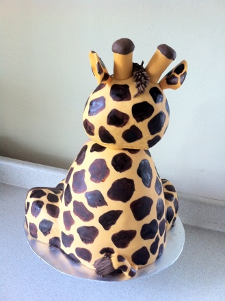 Back view of giraffe baby shower cake