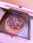 Supreme Pizza birthday cake with all of the toppings