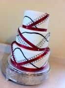 Abstract red ribbon white & black wedding cake