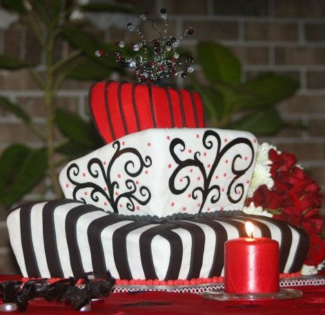"""Tiffany"" Whimsical red white black topsy turvy cake"