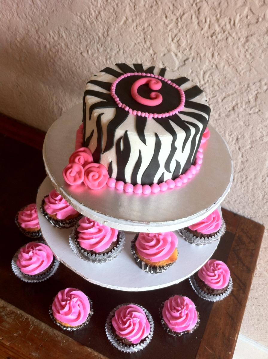 1st birthday zebra smash cake & 24 pink cupcakes.