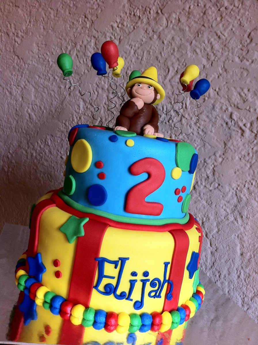 Curious George Birthday Cake with balloons and the yellow hat