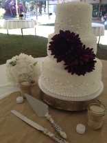 """Danielle"" 3 tier white wedding cake with bubbly dot pattern & purple flowers. Feeds 100. MSRP $405"