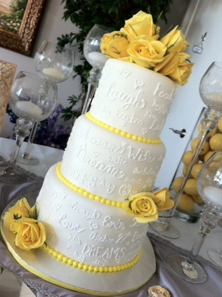 """Erin"" 3 tier wedding cake with love notes & yellow accents. Feeds 75. MSRP $350"