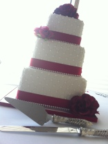 """Holly"" 3 tier wedding cake with quilted pattern, pearls, & red roses. Feeds 100. MSRP $435"