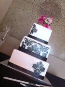 """Kim"" Black Damask wedding cake with pink flowers. Feeds 100. MSRP $420"