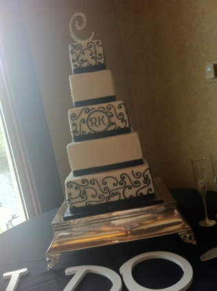 """Kristin"" 5 tier black and white wedding cake with scrolls and monogram"