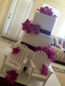 """Leann"" 3 tier square wedding cake with purple ribbon and pink orchids"