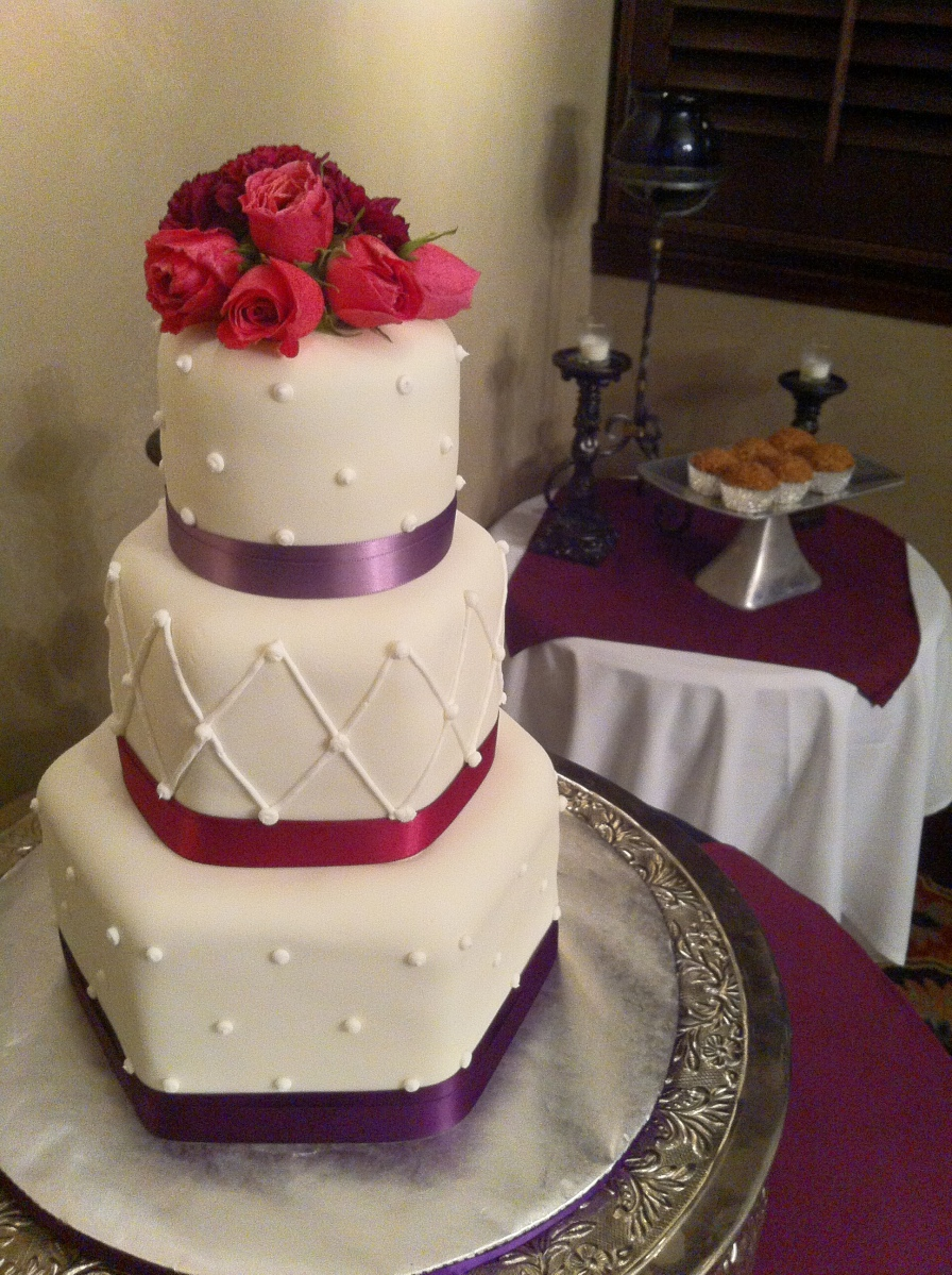 Marcia 3 tier hexagon wedding cake with shades of purple ribbon border and polka dots SanDestin, FL