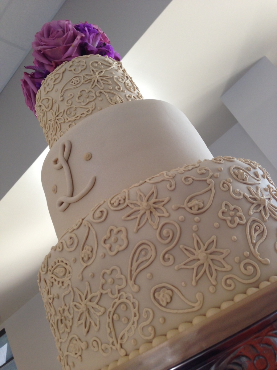 """Rachael"" 3 tier ivory wedding cake with paisley pattern and monogram out in Florala, AL at the edge of Lake Jackson."