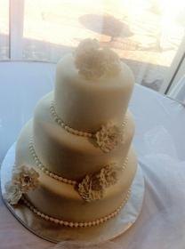 """Soyong"" White on white wedding cake with gumpaste flowers"