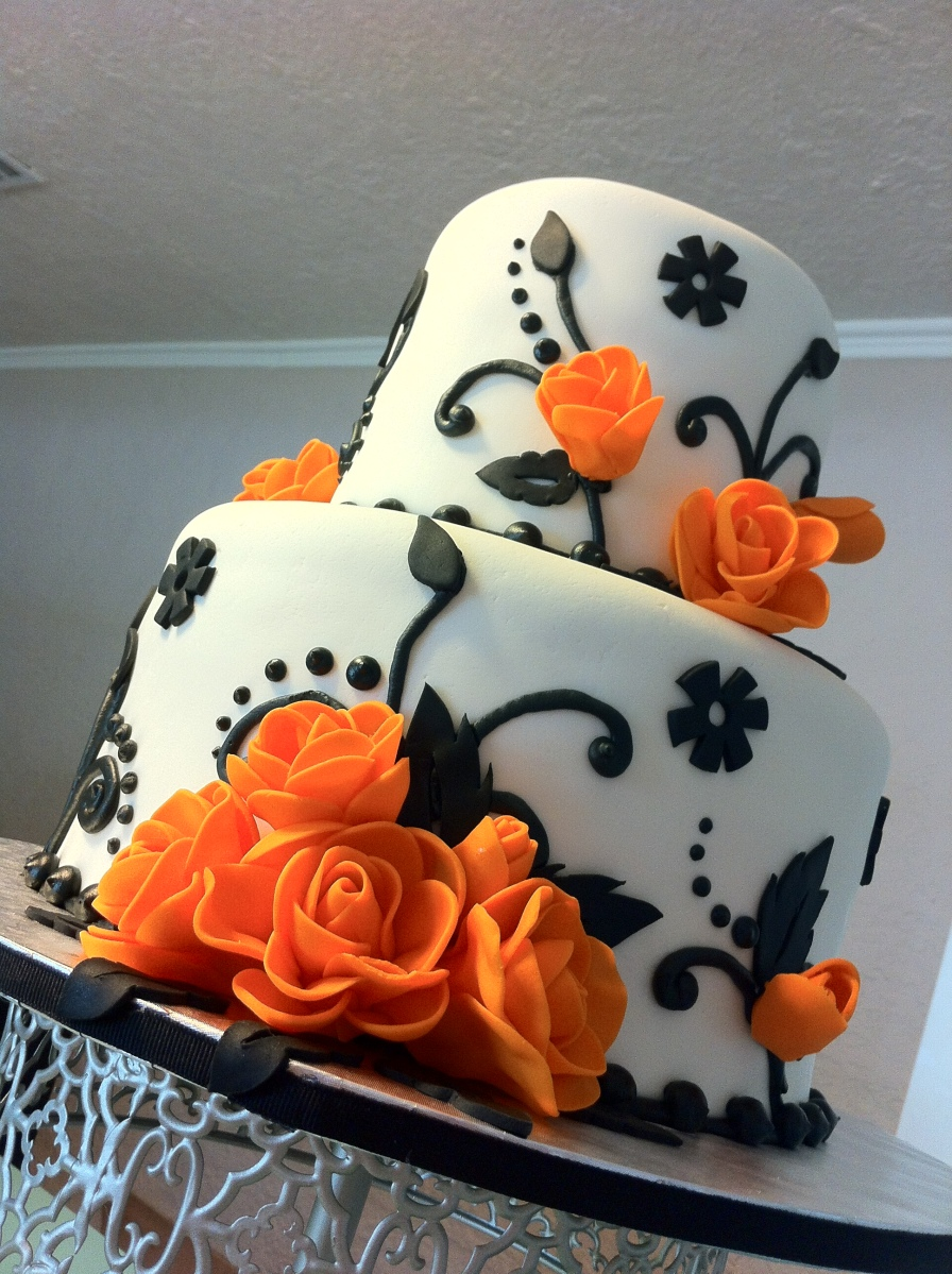 """Tasha"" 2 tier wedding cake with black floral pattern and gumpaste orange roses."