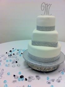 """Tiffany"" Sparkles 3 tier round and square wedding cake in white with rhinestone blue border. Chautauqua Hall of Brotherhood in Defuniak Springs, FL"